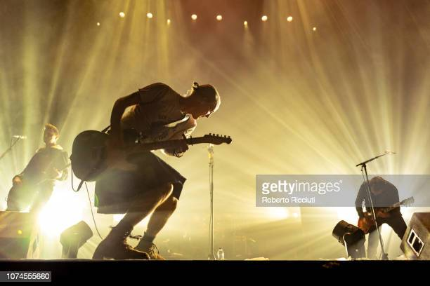 Dougie Payne, Fran Healy and Andy Dunlop of Travis perform on stage at The SSE Hydro on December 21, 2018 in Glasgow, Scotland.