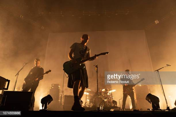 Dougie Payne, Fran Healy, Neil Primrose and Andy Dunlop of Travis perform on stage at The SSE Hydro on December 21, 2018 in Glasgow, Scotland.