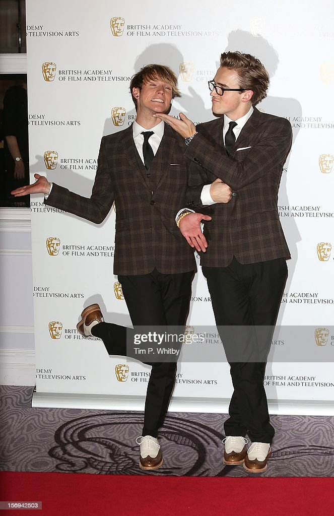 Dougie Poynter and Tom Fletcher pose for a photograph in the press room at the British Academy Children's Awards at London Hilton on November 25, 2012 in London, England.