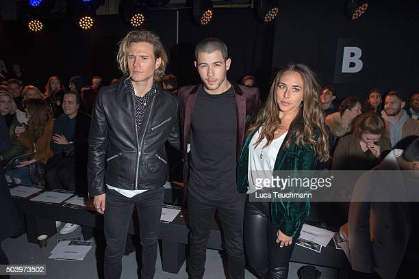 Dougie Poynter Nick Jonas and Chloe Green attend the TOPMAN Design Front Row during The London Collections Men AW16 at on January 8 2016 in London...