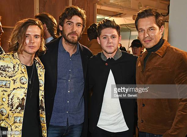 Dougie Poynter Robert Konjic Niall Horan and Paul Sculfor pose backstage at the Oliver Spencer AW17 Catwalk Show during London Fashion Week Men's...
