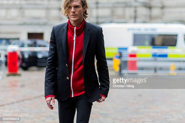 Dougie Poynter wearing a sweat jacket and black blazer outside Belstaff during The London Collections Men SS17 on June 12 2016 in London England