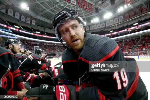 Dougiie Hamilton of the Carolina Hurricanes prepares himself for an overtime period against of the San Jose Sharks during an NHL game on October 26...
