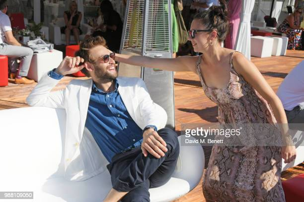 Douglas Booth and Bel Powley attend the Audi Polo Challenge at Coworth Park Polo Club on June 30 2018 in Ascot England