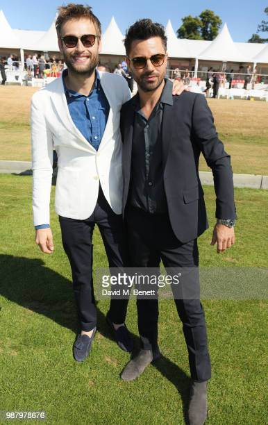 Douglas Booth and Dominic Cooper attend the Audi Polo Challenge at Coworth Park Polo Club on June 30 2018 in Ascot England