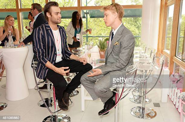 Douglas Booth and Freddie Fox attend the evian Live Young suite on the opening day of Wimbledon at the All England Lawn Tennis and Croquet Club on...
