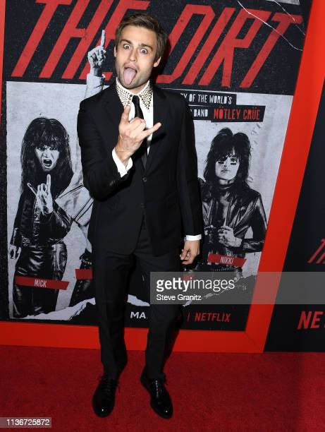 Douglas Booth arrives at the Premiere Of Netflix's The Dirt at ArcLight Hollywood on March 18 2019 in Hollywood California