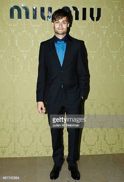 Douglas Booth attends the Miu Miu Resort Collection 2015 at Palais d'Iena on July 5 2014 in Paris France