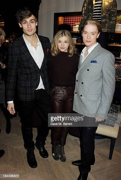 Douglas Booth Chloe Moretz and Freddie Fox attend the VIP Opening of the new Tommy Hilfiger Flagship Store on December 1 2011 in London England