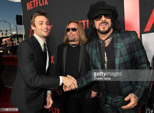 Douglas Booth Vince Neil and Nikki Sixx attend the premiere of Netflix's 'The Dirt at the Arclight Hollywood on March 18 2019 in Hollywood California