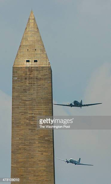 Douglas C53 Skytrooper and a Douglas C47 Skytrain fly past the Washington Monument part of a World War II planes fly over the National Mall to makr...
