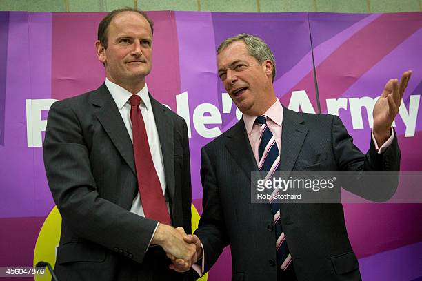Douglas Carswell and Nigel Farage shake hands after a UK Independence Party meeting at Clacton Coastal Academy on September 24 2014 in ClactononSea...