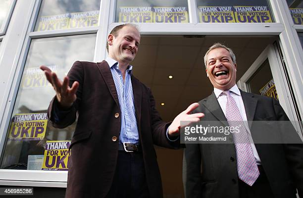 Douglas Carswell of the UK Independence Party stands with party leader Nigel Farage on October 10 2014 in ClactononSea England Mr Carswell will...