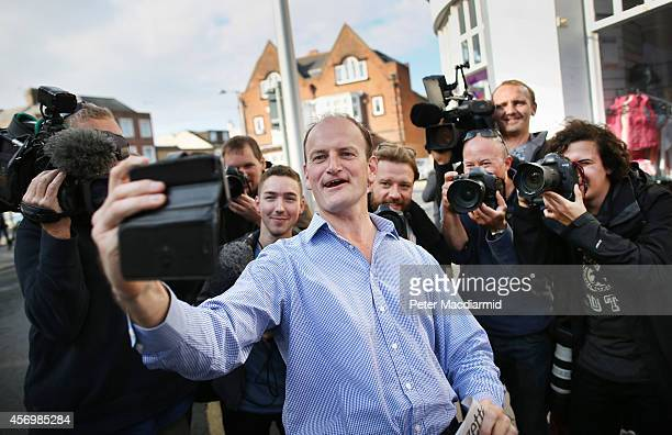 Douglas Carswell of the UK Independence Party takes a selfie phone photograph with photographers on October 10 2014 in ClactononSea England Mr...