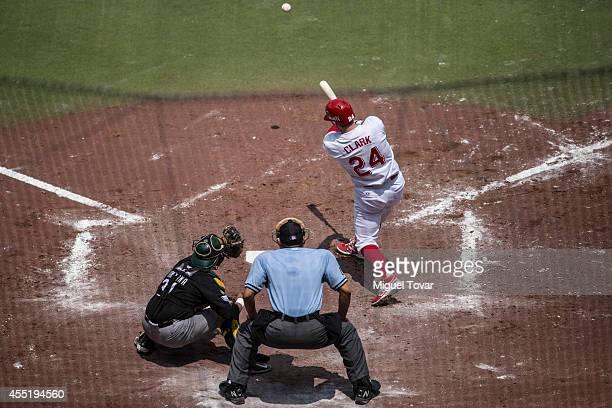 Douglas Clark of Diablos hits the ball during a match between Pericos de Puebla and Diablos Rojos as part of Serie del Rey Mexican Baseball League at...