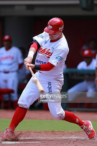 Douglas Clark of Diablos Rojos hits the ball during a playoffs match between Vaqueros Laguna and Diablos Rojos as part of the Mexican Baseball League...