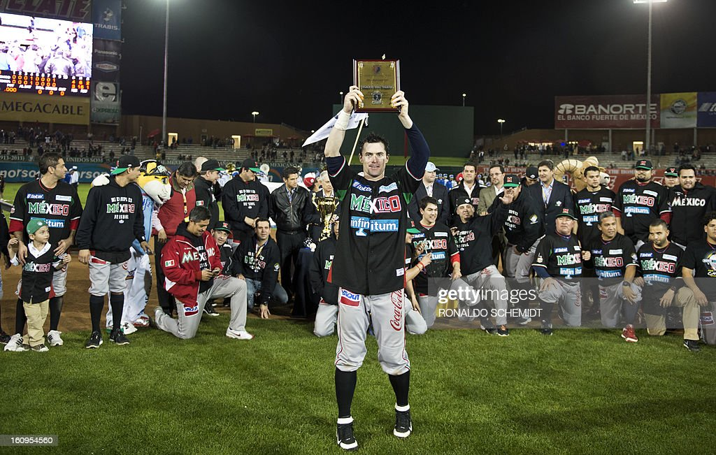 Douglas Clark of Yaquis de Obregon of Mexico celebrates as he is named 'The Most Valuable Player', after the final match against Leones del Escogido of Dominican Republic, during the 2013 Caribbean...