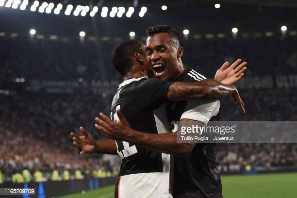 Douglas Costa and Alex Sandro of Juventus celebrate after own goal of Kalidou Koulibaly of SSC Napoli during the Serie A match between Juventus and...
