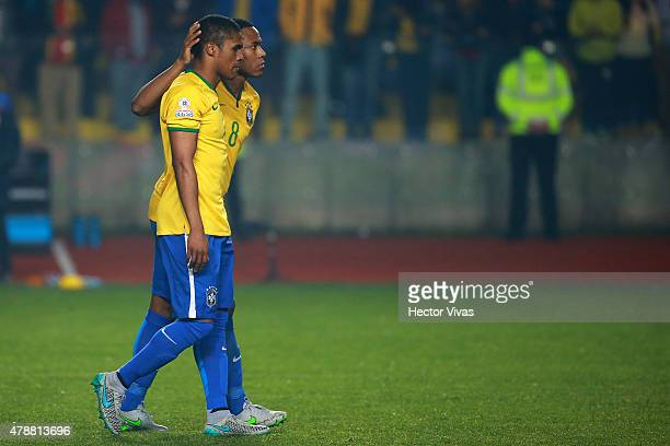 Douglas Costa and Elias of Brazil look dejected after fail the fourth penalty kick in the penalty shootout during the 2015 Copa America Chile quarter...