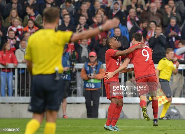 Douglas Costa de Souza and Robert Lewandowski of Bayern Munich celebrate during the UEFA Champions League group F football match between FC Bayern...