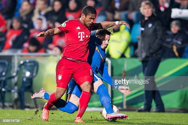 Douglas Costa de Souza of Bayern Munich Stefano Celozzi of VFL Bochum during the Bundesliga match between VfL Bochum and Bayern Munich on February 4...