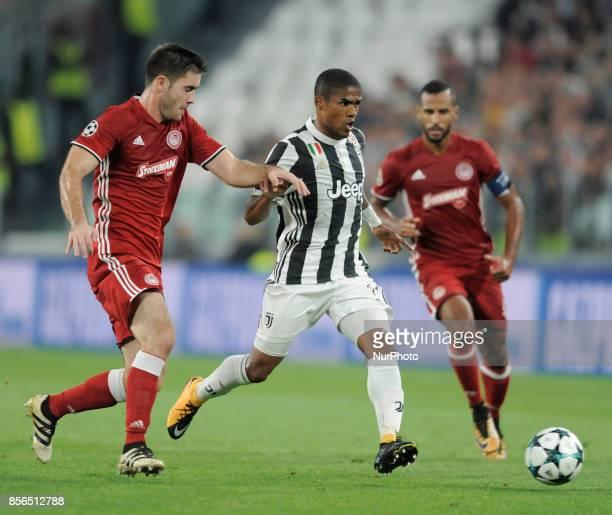 Douglas Costa de Souza of Juventus player Sasa Zdjelar of Olympiacos player and Alaixys Romao of Olympiacos player during the Uefa Champions League...