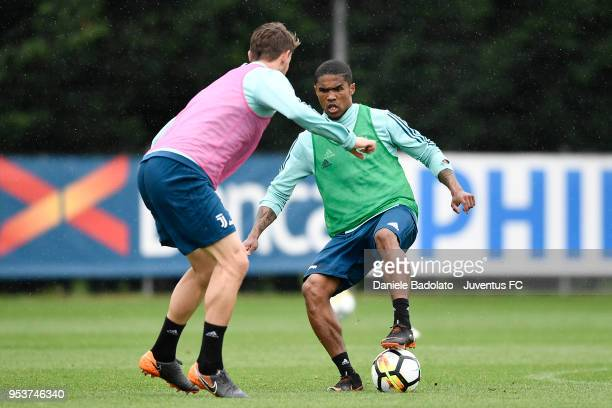 Douglas Costa during the Juventus training session at Juventus Center Vinovo on May 2 2018 in Vinovo Italy