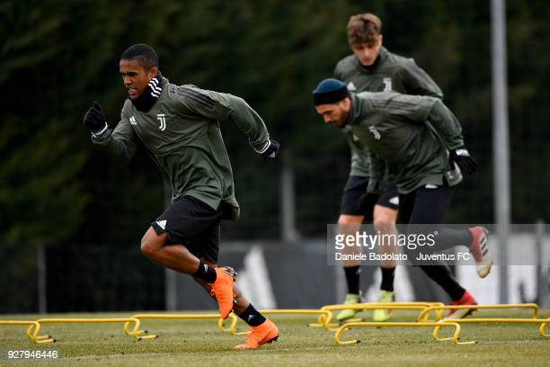 Douglas Costa during the training session before the Champions League match between Tottenham Hotspur and Juventus at Juventus Center Vinovo on March...