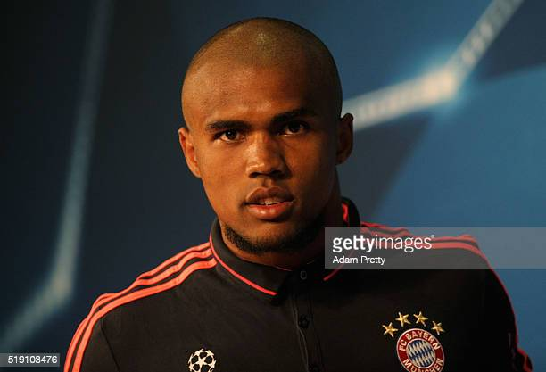 Douglas Costa looks on during a FC Bayern Muenchen press conference ahead of their UEFA Champions League quarter final first leg match against...