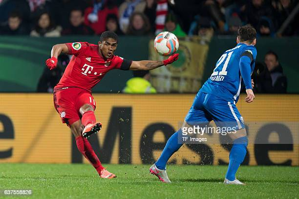 Douglas Costa of Bayern Muenchen and Stefano Celozzi of Bochum battle for the ball during the DFB Cup quarter final match between VfL Bochum and...