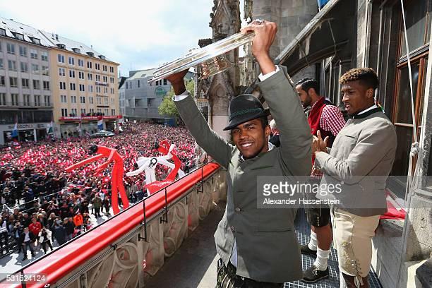 Douglas Costa of Bayern Muenchen celebrate winning the German Championship title on the town hall balcony at Marienplatz on May 15 2016 in Munich...