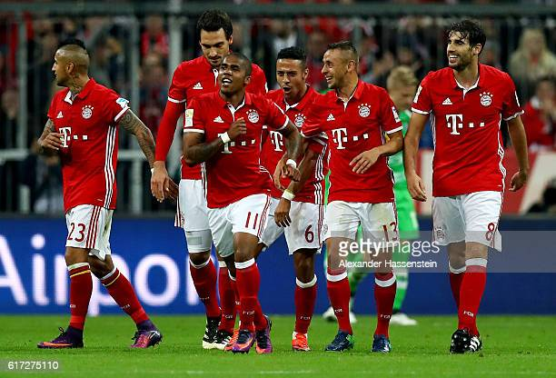 Douglas Costa of Bayern Muenchen celebrates after he scores his team's 2nd goal during the Bundesliga match between Bayern Muenchen and Borussia...