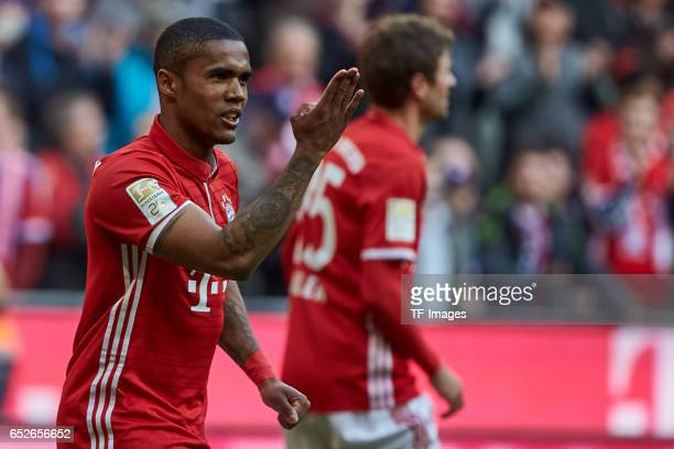 Douglas Costa of Bayern Muenchen celebrates after scoring his teams second goal during the Bundesliga match between Bayern Muenchen and Eintracht...