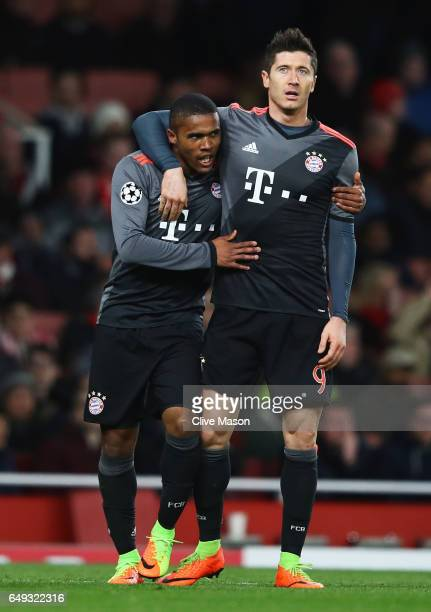 Douglas Costa of Bayern Muenchen celebrates as he scores their third goal with Robert Lewandowski during the UEFA Champions League Round of 16 second...