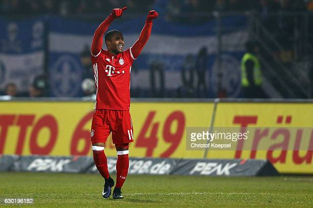 Douglas Costa of Bayern Muenchen celebrates the first goal during the Bundesliga match between SV Darmstadt 98 and Bayern Muenchen at Stadion am...