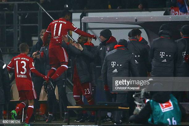 Douglas Costa of Bayern Muenchen celebrates the first goal with Arturo Vidal of Bayern Muenchen during the Bundesliga match between SV Darmstadt 98...