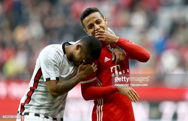 Douglas Costa of Bayern Muenchen celebrates with Thiago of Bayern Muenchen after winning the Bundesliga match between Bayern Muenchen and Eintracht...