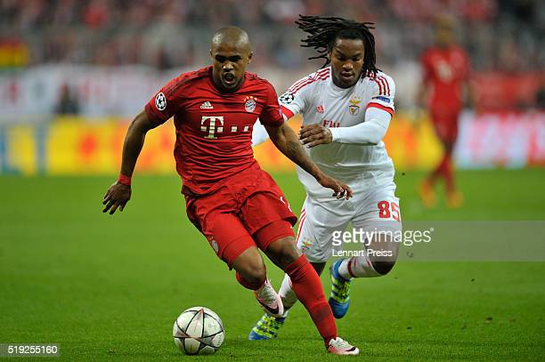 Douglas Costa of Bayern Muenchen challenges Renato Sanches of Benfica during the UEFA Champions League Quarter Final first leg match between FC...