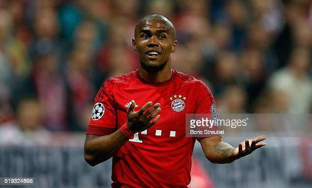 Douglas Costa of Bayern Muenchen gestures during the UEFA Champions League quarter final first leg match between FC Bayern Muenchen and SL Benfica at...