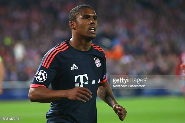 Douglas Costa of Bayern Muenchen runs during the UEFA Champions League semi final first leg match between Club Atletico de Madrid and FC Bayern...