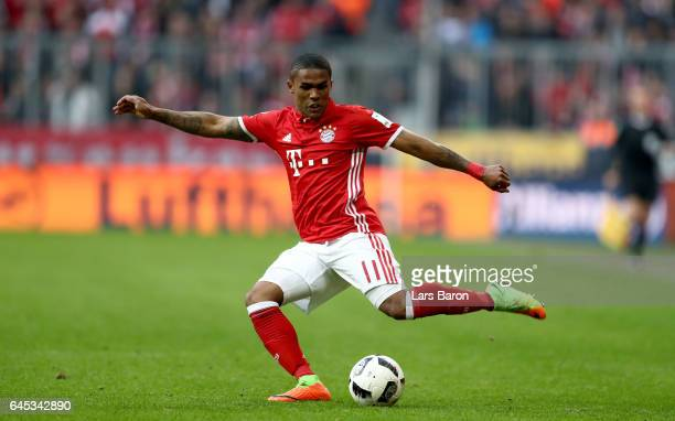 Douglas Costa of Bayern Muenchen runs with the ball during the Bundesliga match between Bayern Muenchen and Hamburger SV at Allianz Arena on February...