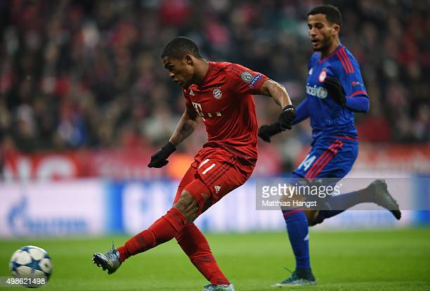 Douglas Costa of Bayern Muenchen scores the opening goal during the UEFA Champions League group F match between FC Bayern Munchen and Olympiacos FC...