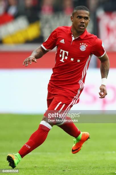 Douglas Costa of Bayern Munich in action during the Bundesliga match between 1 FC Koeln and Bayern Muenchen at RheinEnergieStadion on March 4 2017 in...