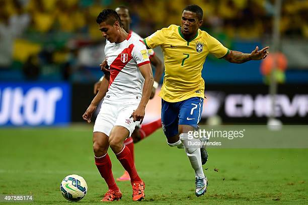 Douglas Costa of Brazil battles for the ball with Paolo Hurtado of Peru during a match between Brazil and Peru as part of 2018 FIFA World Cup Russia...