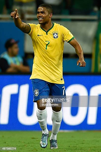 Douglas Costa of Brazil celebrates a goal during a match between Brazil and Peru as part of 2018 FIFA World Cup Russia Qualifiers at Arena Fonte Nova...