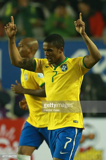 Douglas Costa of Brazil celebrates after scoring the second goal of his team during the 2015 Copa America Chile Group C match between Brazil and Peru...