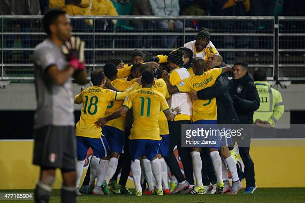 Douglas Costa of Brazil celebrates with teammates after scoring the second goal of his team during the 2015 Copa America Chile Group C match between...