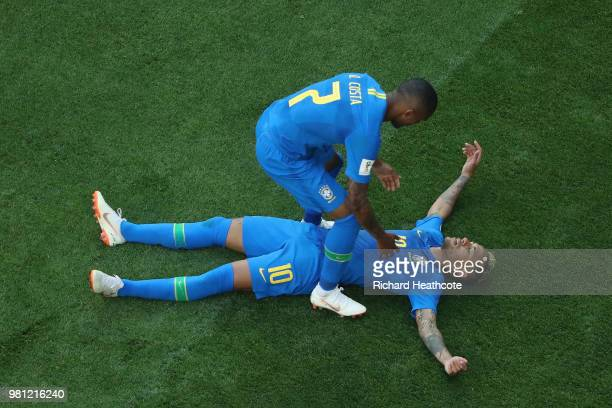 Douglas Costa of Brazil helps Neymar Jr of Brazil to his feet during the 2018 FIFA World Cup Russia group E match between Brazil and Costa Rica at...