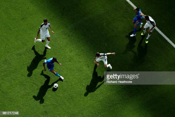 Douglas Costa of Brazil is challenged by Bryan Ruiz and Bryan Oviedo of Costa Rica during the 2018 FIFA World Cup Russia group E match between Brazil...