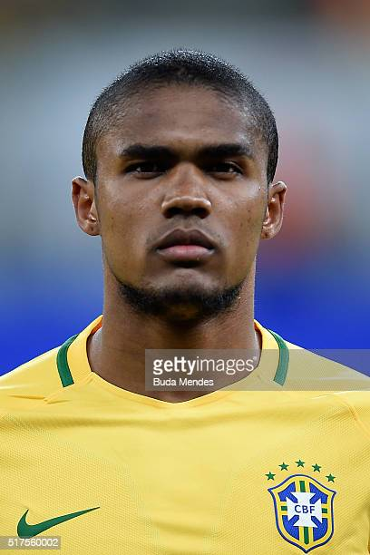 Douglas Costa of Brazil looks on during a match between Brazil and Uruguay as part of 2018 FIFA World Cup Russia Qualifiers at Arena Pernanbuco on...